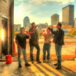 Warped Wing Brewing Partners in the brewery with downtown Dayton in the background 09/30/2013, left to right:Joe Waizmann,  Nick Bowman, Mike Stover.John Haggerty, Photo courtesy of WWBC, Inc.